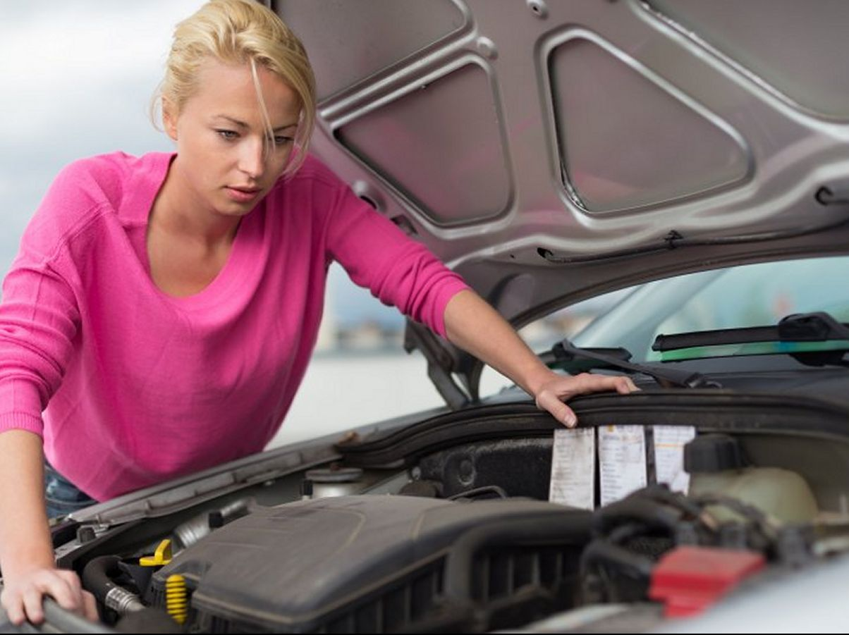 woman under car bonnet